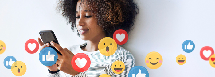 Woman on phone with emojis floating around